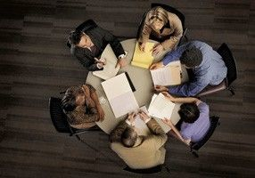Birds-eye-view-of-business-people-sitting-round-a-table